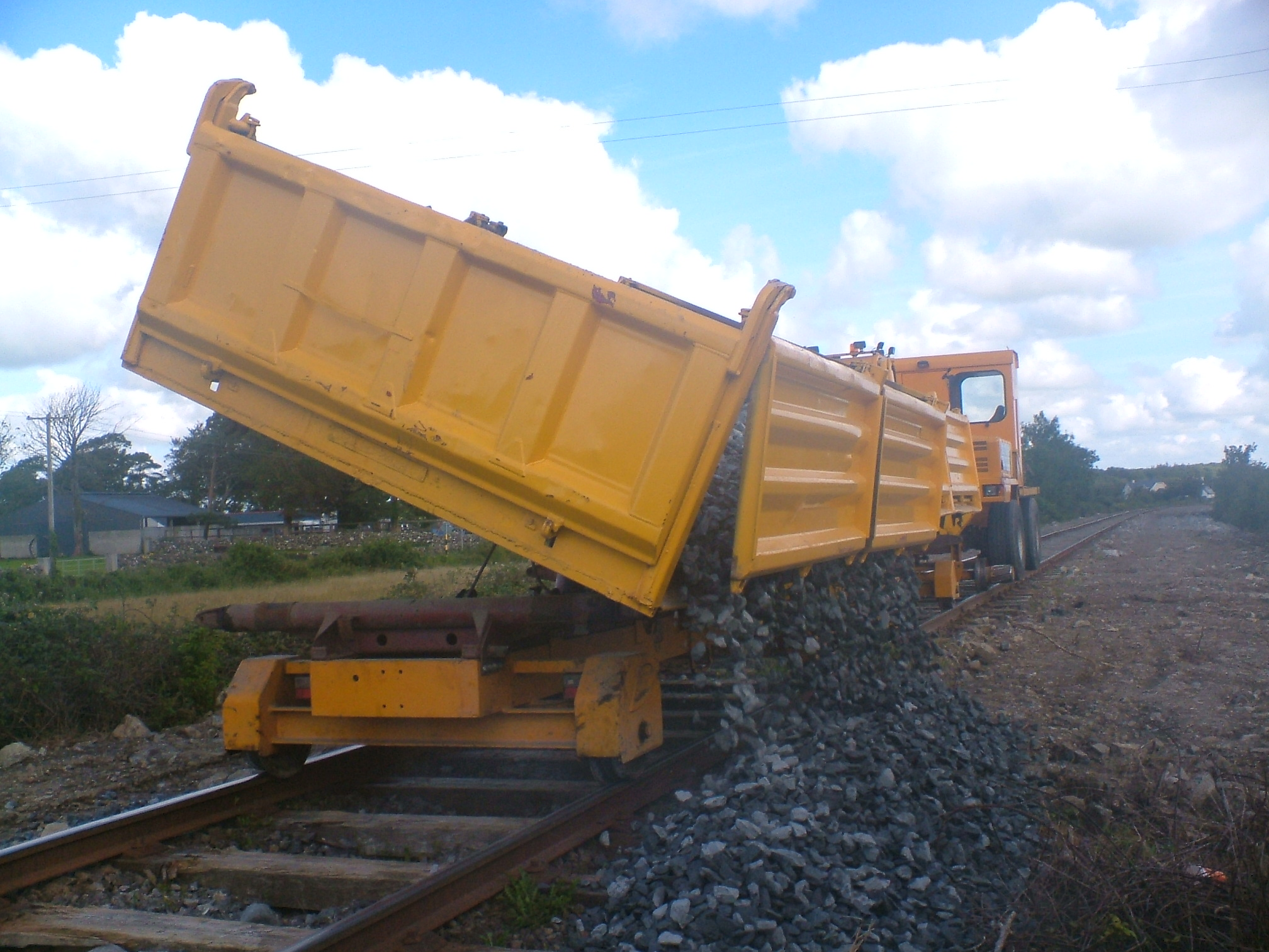 Dumper-tipping-ballast-from-3-way-tipping-trailer1
